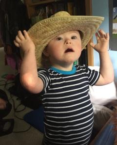T in cowboy hat