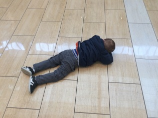 T on floor of Apple store